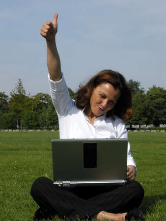 Yeah - thumbs up - Woman is pleased with success Stock Photo - 10745762