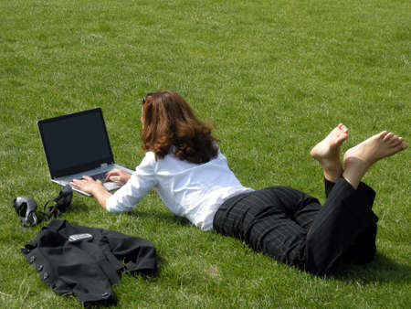 Business woman works in a relaxed way outdoor