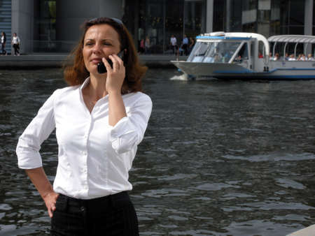 tense: the business woman is tense during a telephone call Stock Photo
