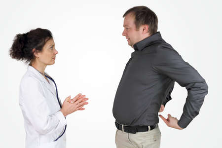 intervertebral disc:  Back pain - the male patient describes and shows his problem with his back Stock Photo
