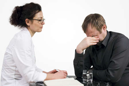 family physician: Talk therapy - Patient weeps as he describes his problems Stock Photo
