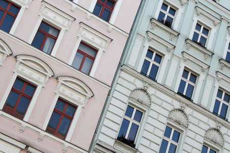 old building facades: rose-colored and blue house - Renovated old building facades Stock Photo