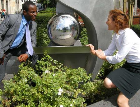 Flirt - two businessmen meet in the break and flirt photo