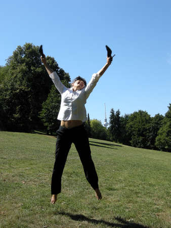 Jump joy - Woman jumping for joy in the air photo
