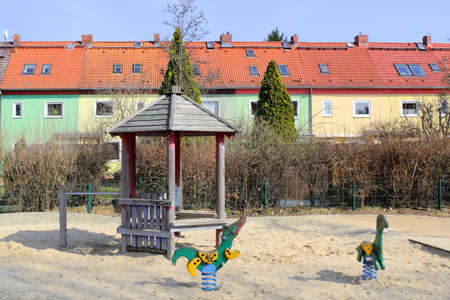 bausparen: Terraced houses with playground Stock Photo