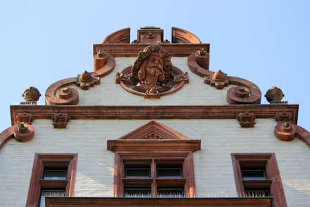heads old building facade: Gable in Halle (Saale), Germany