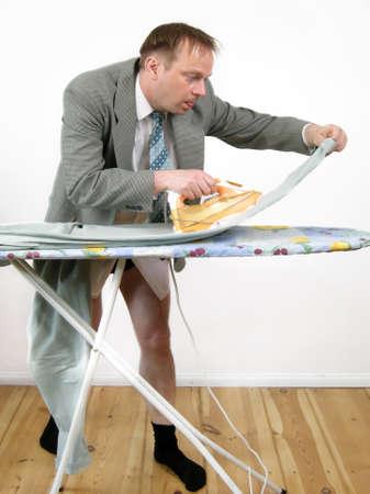 meticulous: Businessman ironing