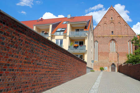 Wall, new building and the church Stock Photo - 12442060