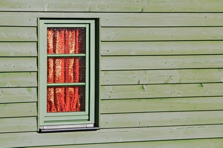 Wooden facade with window photo