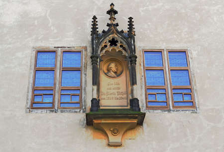 heads old building facade: Luther House window