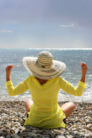 Meditating by the sea photo