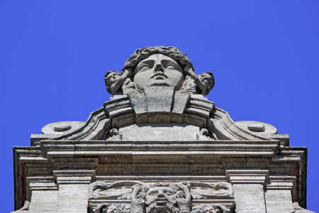 heads old building facade: New City Hall Detail