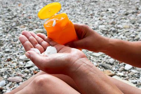 anoint: Applying suntan lotion