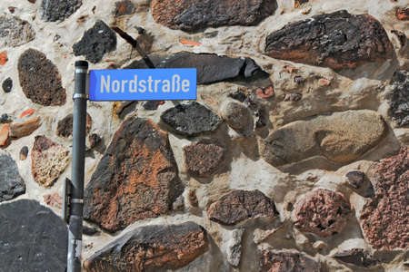 castle conditioning: street sign and field stones