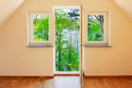 better living: Window with green view Stock Photo