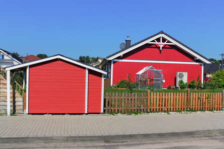better living: red wooden house