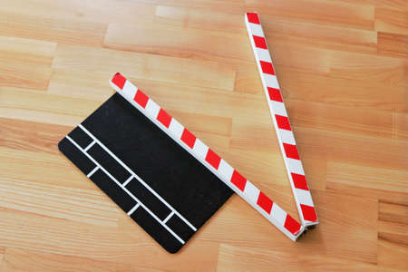 Clapperboard on parquet photo