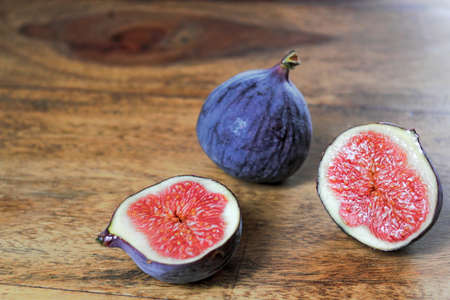 bowel movement: Figs on wooden table