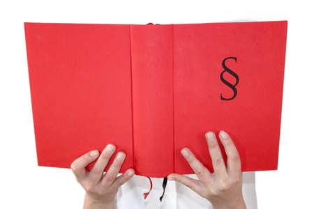 persona leyendo: Persona Unindentified libro de ley de lectura