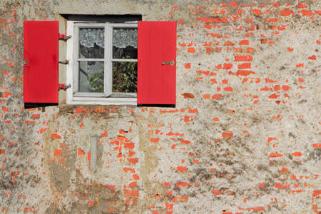 substantiate: old wall with window