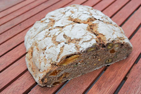 Fruit nut bread on wooden table photo