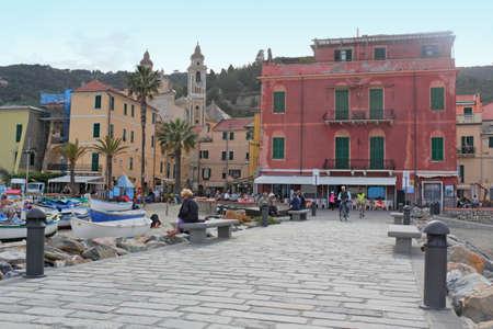 small town life: Laigueglia beach promenade