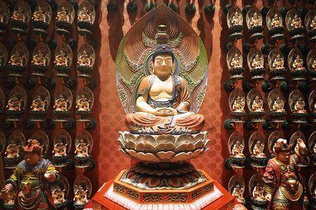 chinese buddha: Chinese buddha statue with small buddha on background