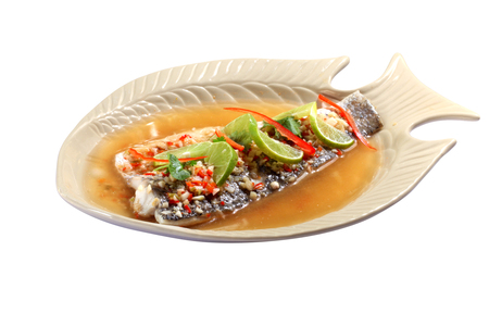 Thai Spicy steamed fish fillet with chopped chillis spicy sauce (Pla Nueng Ma Now) Stock Photo
