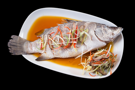 Thai steamed sea-bass fish with soya sauce (Pla Neung See Eew)