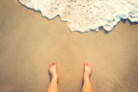 painted toenails: Standing on the beach with wave coming