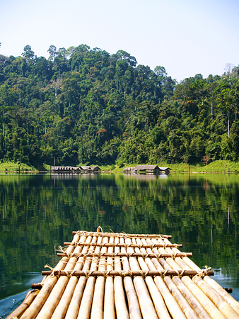 Bamboo rafting on the tropical lake, Thailand