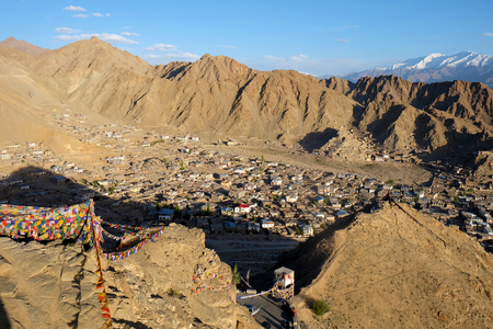 Leh district view from hight top Namgyal Tsemo Gompa with mantra flags Stock Photo