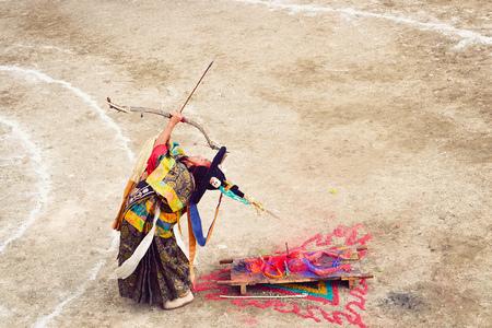 LAMAYURU, INDIA - JUNE 22, 2017: Unidentified buddhist lamas dressed in mystical mask dancing Tsam mystery dance in time of Yuru Kabgyat Buddhist festival at Lamayuru Gompa, Ladakh, North India