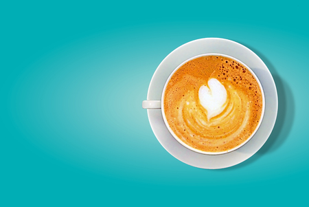 a cup of hot coffee latte with heart shape isolated on chic background with clipping path