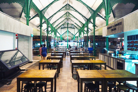 Singapore - 19 MAY 2015: Singapore Telok Ayer food center at night time all shop nearly close at this time without people sitting on table