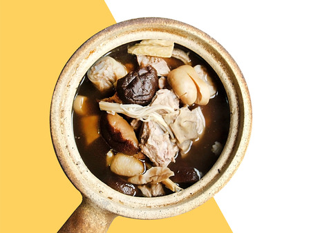 Bak Kut Teh - Chinese pork bone in herbal soup isolated on white background
