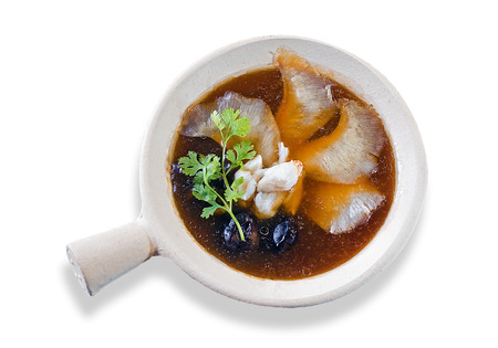 chinese shark fin soup served on hot clay pot isolated on white background