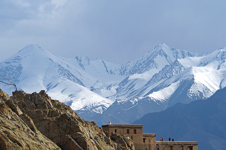 India - June 16 2017: Tourist on top of Leh Palace with Snow Mountain on Background