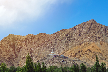 Shanti stupa with beautiful sky and forest, the big buddhist stupa in Leh - Jammu and Kashmir - Ladakh - India