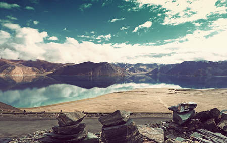 Vintage scene - Pangong Lake in Ladakh, North India. Pangong Tso is an endorheic lake in the Himalayas situated at a height of about 4,350 m. It is 134 km long and extends from India to Tibet