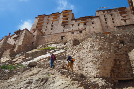 Unidentified people hiking up to Leh Palace, Leh - India