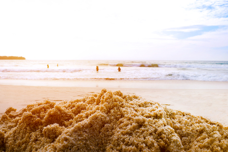 Summer beach sand pile with blur sea background Foto de archivo