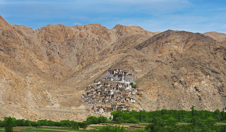 Beautiful scenic view - Tatok Buddhist Monastery (Gompa) against the background of  mountain wall on the way to Pangong Lake road, Ladakh, Himalaya, Jammu & Kashmir, India
