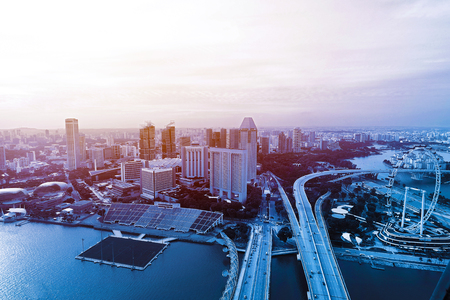 Blue tone modern Singapore cityscape finance district view skyline background with singapore flyer on the right