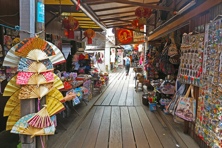 Malaysia - AUGUST 18 2017: Tourists exploring local souvenir shops in Chew Jetty fishing village in Georgetown Penang Malaysia