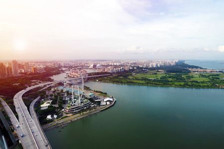 aerial view of Singapore city with the highway bridge and singapore flyer at evening time