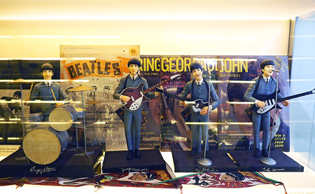 Singapore - JUNE 21 2015: The Beatles Band vintage figure model in MINT museum of toys in Singapore
