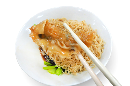 Traditional Chinese Noodle with wantan (dumpling) on eating with chopstick in isolated white