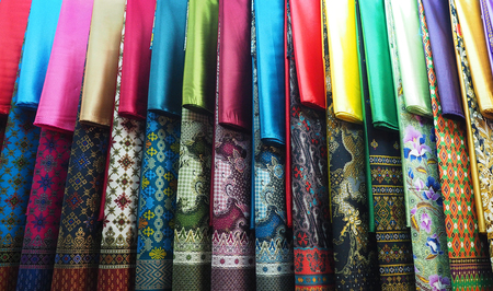 row of colorful set Kebaya skirt dress in local market display