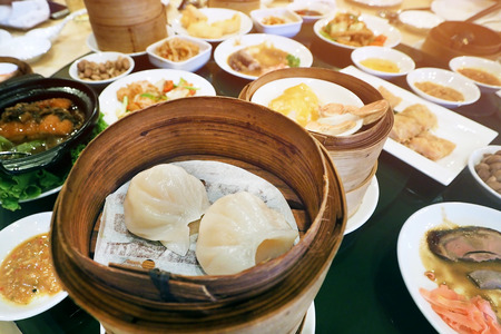 asian food - enjoy eating quality varieties of Dim Sum Dumplings served on bamboo basket at restaurant Stock Photo